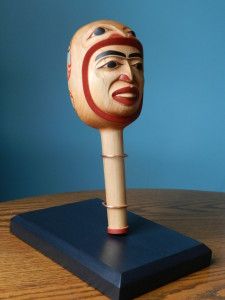 """Woman who was taken by the Frog People"" rattle 12"" x 4"" alder"