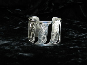 Silver salmon-orca-human cuff bracelet 1 3/4 inches wide